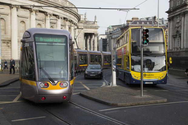 Trams, taxis and buses compete for space in College Green. Photo: Colin O'Riordan