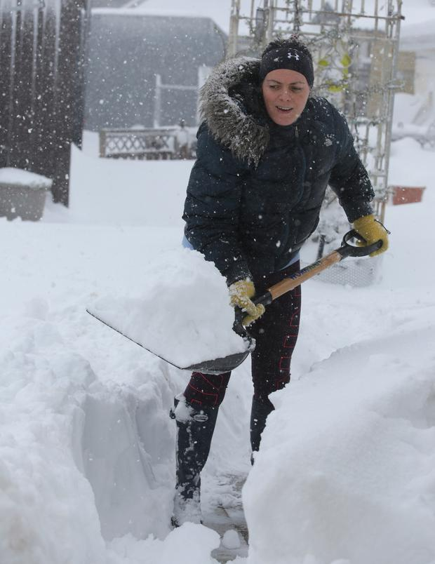 Therese Eagers digs a pathway in her back garden in Rathcoole