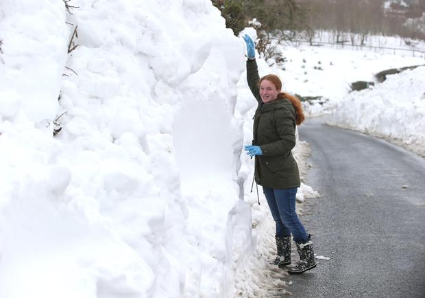 Amy O'Neill from Kilteel, Co. Kildare shows the level of snow on the Kilteel Road