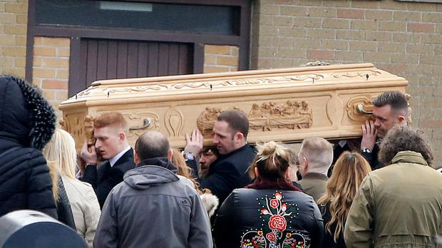 Kenneth Finn's coffin being carried out of the church
