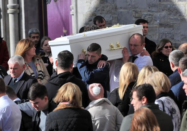 Mourners at St Mary's Church, Navan, carry the coffin of little Kayla Carey, who died last week after contracting meningitis