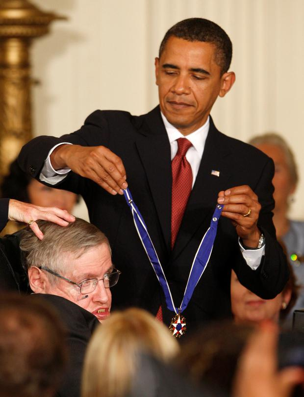 Barack Obama presenting him with the Presidential Medal of Freedom. Photo: Reuters