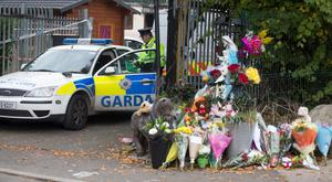 Floral tributes left at the scene of the 2015 Carrickmines fire