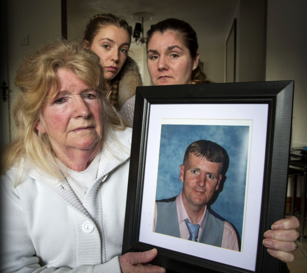 Margaret Mooney holding a photo of her late son Wesley, with daughter Jolene (right) and niece Jemma (centre)