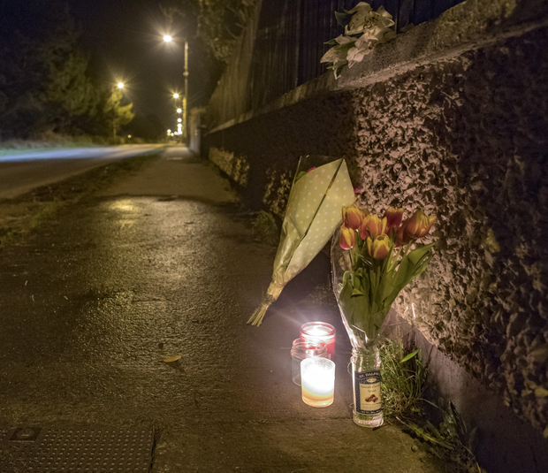 Flowers and candles left at the scene