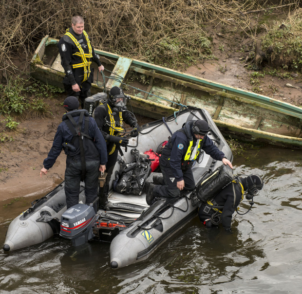 Members of the gardai and the Civil Defence search for missing teenager Elisha Gault on the River Suir in Co Tipperary, yesterday