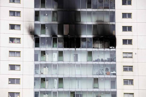 Fire blackened windows at the Metro Hotel yesterday