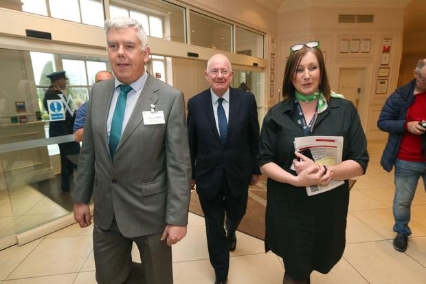 Justice Minister Charlie Flanagan (centre) is led into AGSI conference by general secretary John Jacob and president Antoinette Cunningham