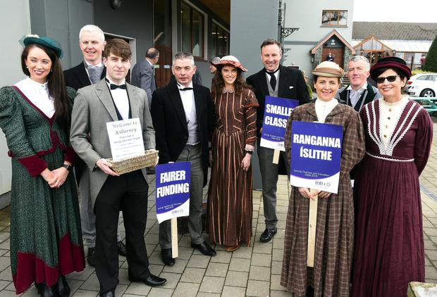 Teachers dressed in 19th century attire welcome their colleagues to the INTO conference