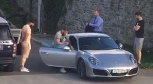 Conor McGregor messes with his pals before getting into a silver Porsche