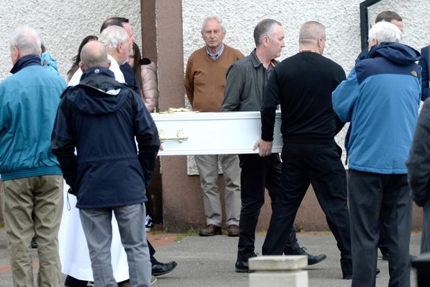 The coffin of Michael Stokes is carried into the church in Malahide