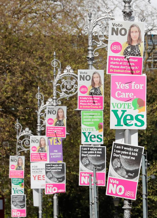 Posters calling for a Yes and No vote in next week's referendum