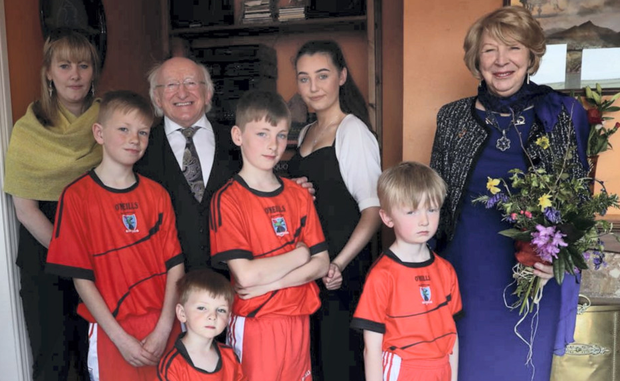 Emma Mhic Mhathuna (left) and her children with President Michael D Higgins and his wife Sabina (right) in Co Kerry