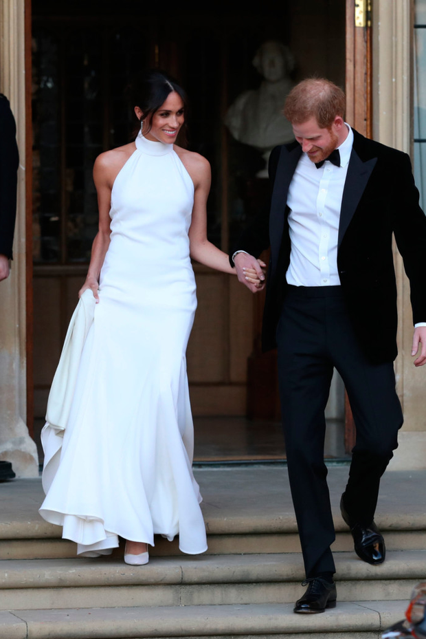 Meghan Markle in the Stella McCartney dress with husband Harry. Photo: Steve Parsons