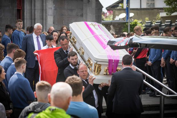 Mourners outside St Peter and Paul Cathedral for the funeral of Shay Moloney