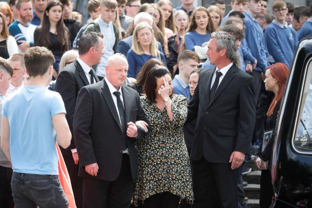 Family members and mourners outside St Peter and Paul Cathedral for the funeral of Shay Moloney