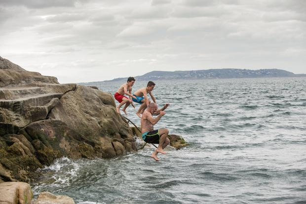Home from New Zealand and enjoying a dip at the Forty Foot, Sandycove, are James Russell with sons Flynn (10) and Paddy (8)