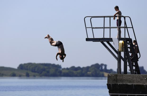 Enda O'Carolan, a local from Mullingar, jumps into Lough Ennell