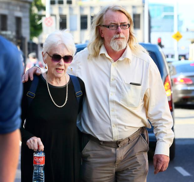 Tressa Donnelly Reeves and Patrick Farrell outside court