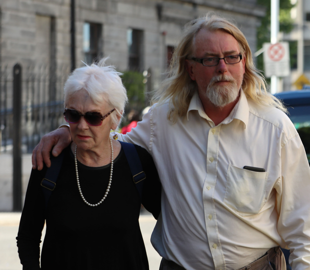 Tressa Reeves and her son, Patrick Farrell, outside court