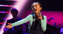 Savannah performing for top music stars on The Voice Kids