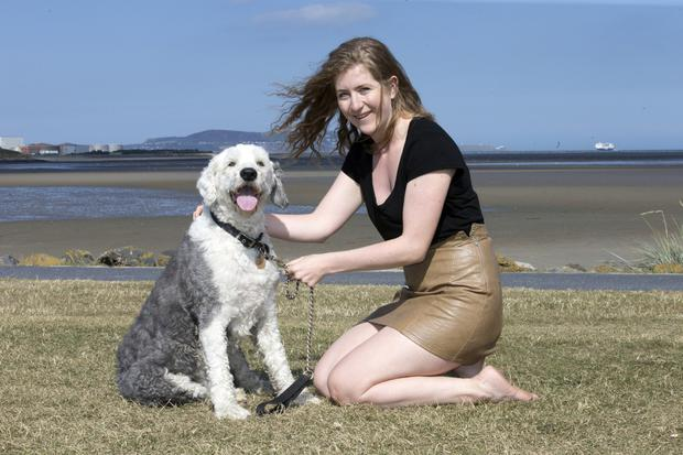 Martha Higgins with her dog Mojo at Sandymount
