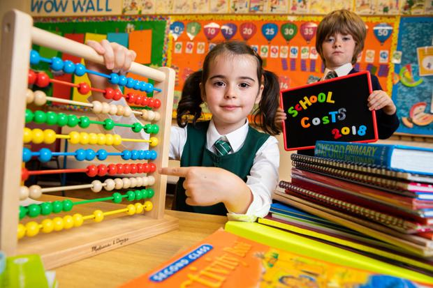 Daisy O'Connor and Patrick Regan (both 6) at the launch of the annual Barnardos school costs survey