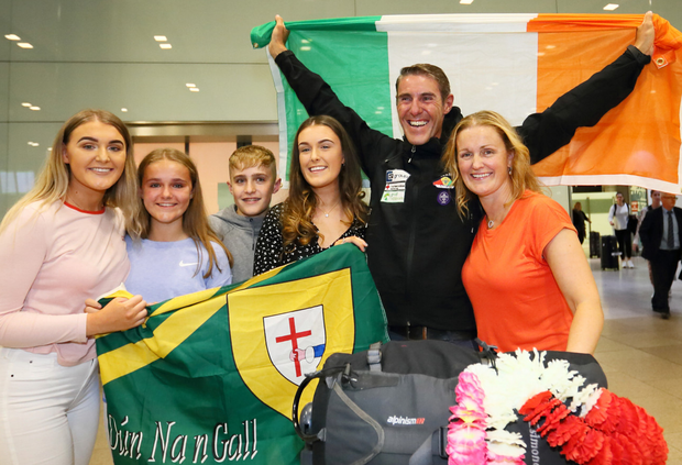 Irish climber Jason Black is greeted by his wife Sharon and children Kate, Ella, Billy and Laura as he arrives back home. Pic: Frank McGrath