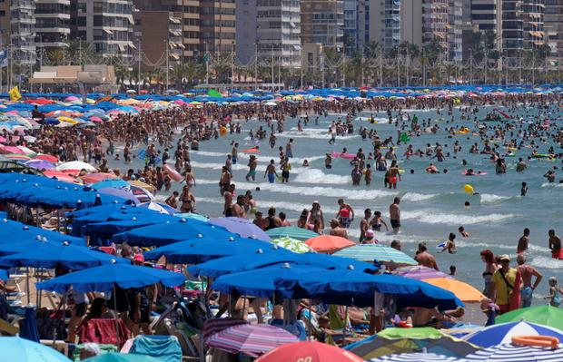 A packed beach in Benidorm