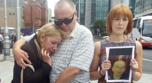 Cathy and Anthony Robertson, the parents of victim Karl Robertson outside court with his cousin Aisling Reid