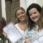 Institute of Education students Lily Farrell, Niamh Corry and Lucy Mockler with their Leaving Cert exam results