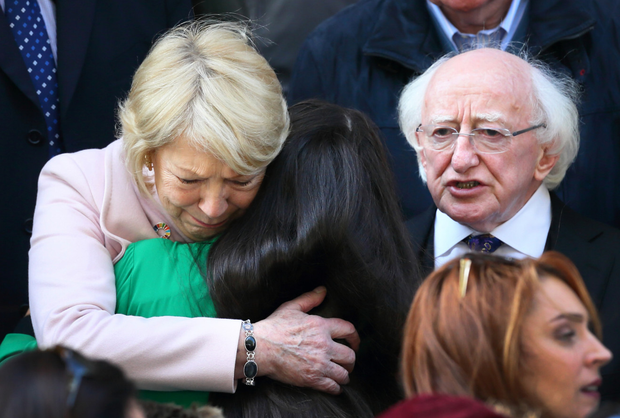 Emma's daughter Natasha is embraced by Sabina Higgins with President Michael D Higgins. Picture:Frank McGrath