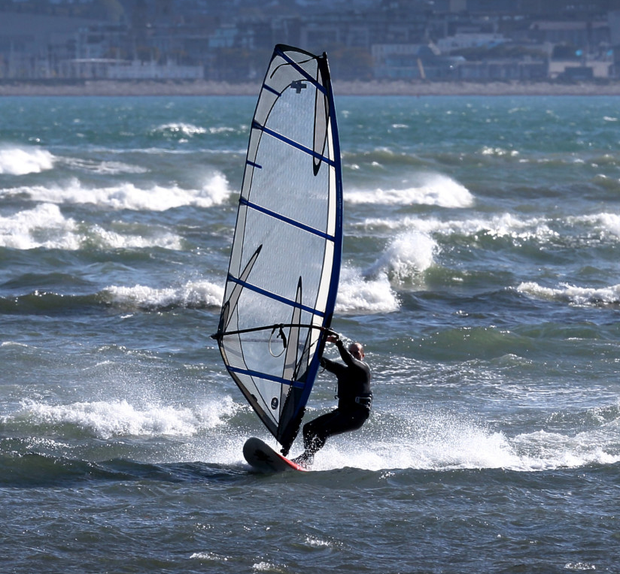 A windsurfer in choppy waters near the South Bull Wall