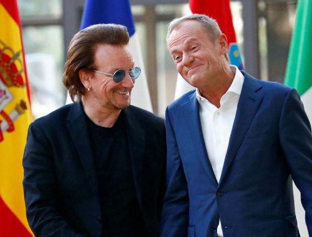Bono and European Council president Donald Tusk. Pic: Reuters