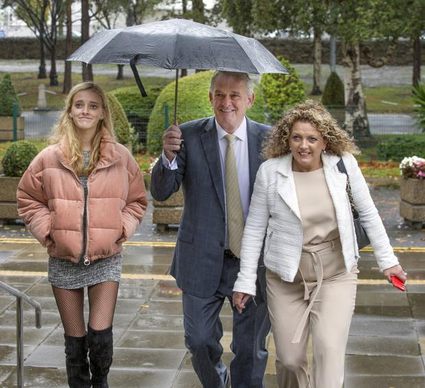 Peter Casey arrives with daughter Siofra and wife Helen for an RTE radio debate.