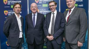 INM technology editor Adrian Weckler, Justice Minister Charlie Flanagan, INM group managing editor Ed McCann and Det Supt Michael Gubbins at Information Sec