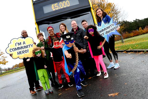 Annalise Murphy (right) with Cooking for Freedom's Mavis Ramazani (back row, third from left) and other Dublin Bus community spirit award winners