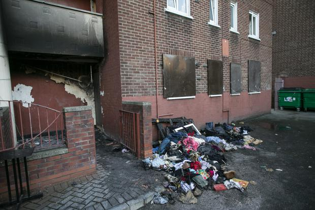 Debris from the burnt-out flat strewn in front of the boarded up property in Dublin's Hardwicke Street