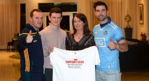 Meath manager Andy McEntee, Jack and Martina Cox and Dubs midfielder Michael Darragh MacAuley at the launch of the Dublin v Meath fundrasising football match in aid of Sean Cox