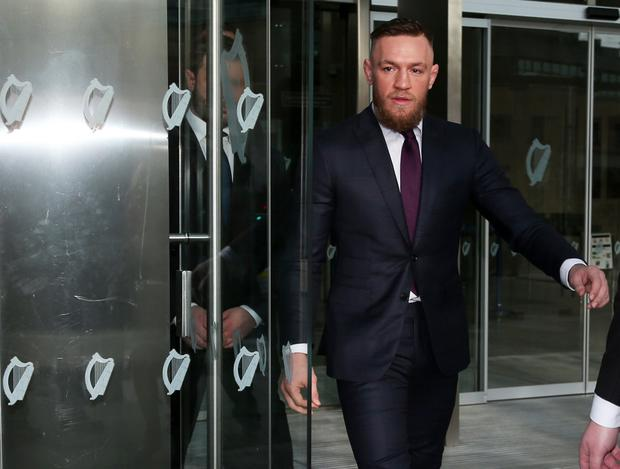 Conor McGregor leaves Dublin District Court after the case was struck out