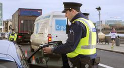Gardai breathalyse drivers at a Custom House checkpoint