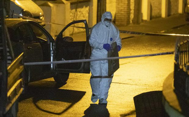 A garda forensic officer at the scene of the gun attack in Bray. Photo: Fergal Phillips