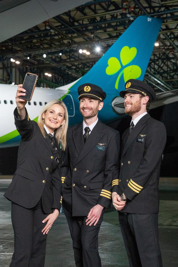 First Officers Laura Bennett, Niall McCauley and Paul Deegan at Aer Lingus's hangar at Dublin Airport in front of an A330-300 painted in the carrier's new livery. Photo: Naoise Culhane Photography