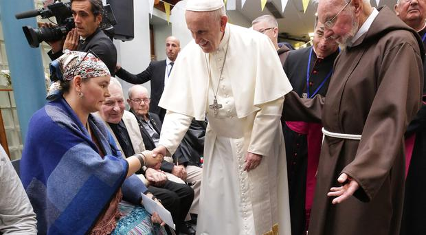 Pope Francis shakes hands with Rosemary Fearson