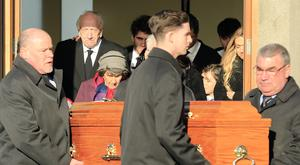 The parents (back left) of Orla Church follow her coffin after the mass