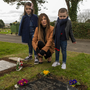 Lisa Lawlor with her children Frankie (8) and Lennon (4) visiting the graves of her parents, Maureen and Francis who died in the Stardust tragedy in 1981