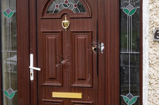Damage to the front door of a house in Corduff Place