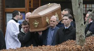 The coffin carrying the body of Patricia Quinn is carried out of church