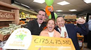 Shop owner Les Reilly (left of main pic) celebrates. Photo: Mac Innes Photography