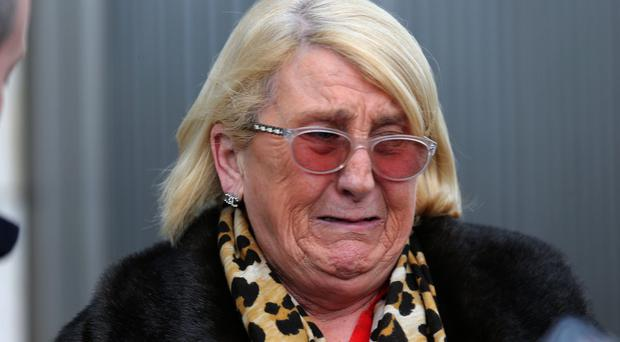 Sadie Byrne, mother of David, weeps outside court